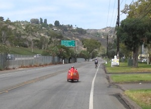 My attempt at drafting the red Fraser velomobile was twarted by my sluggish 'put-away-the-camera' time.