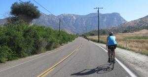 Riding into the mountains on delightfully flat El Monte Rd
